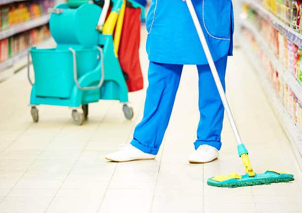 man cleaning up dirty floors Johannesburg cleaning company